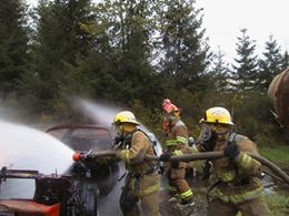 Using Hoses to Put Out a Car Fire